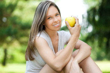 Girl having a healthy apple snack