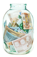 saving euro money in glass jar