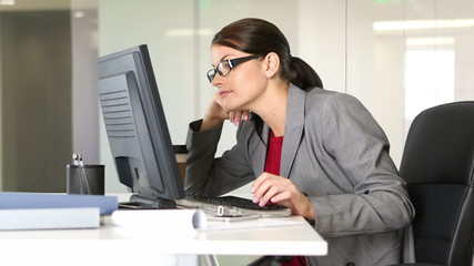 Young businesswoman working on computer at desk