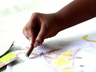 kids filling color his drawing paper