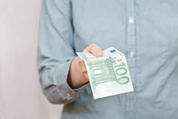 hundred euro banknote in arm