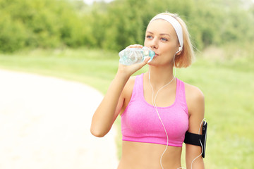 Jogger drinking water in the park