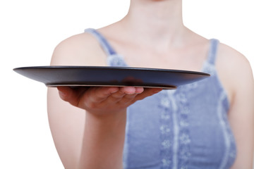 woman holds empty black plate on hand
