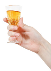 hand holds wineglass of aperitif wine