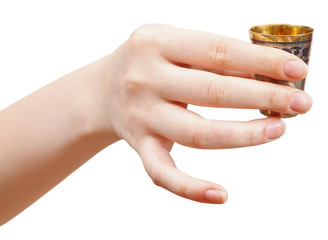 hand holds little metal glass with spirit
