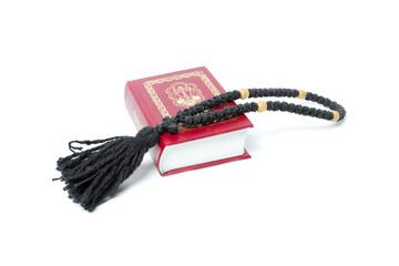 red bible and rosary