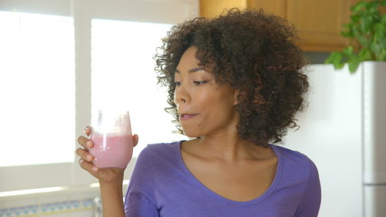 Close up of woman drinking fruit smoothie