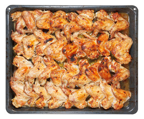 many roasted spicy chicken wings on tray isolated