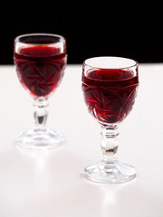 Cherry liqueur in crystal glasses