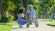 Nurse walking with elderly woman in wheelchair