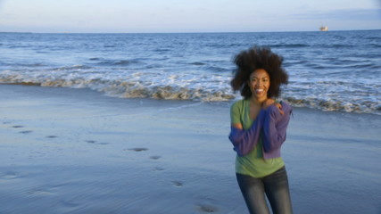 Cute African American woman having fun at beach