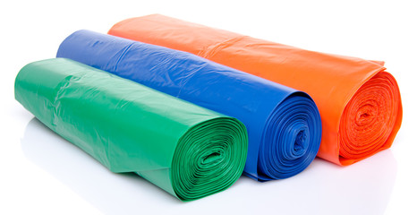 Trash bags in blue, orange and green