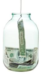 catching saving dollars from glass jar