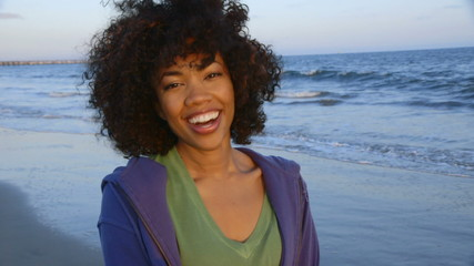 Portrait of woman having fun and smiling at beach