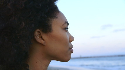 Portrait of woman looking out over the ocean