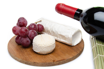Composition of goat cheese on a wooden cutting board
