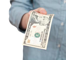 ten dollars banknote in hand