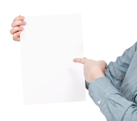 finger pointing on sheet of paper