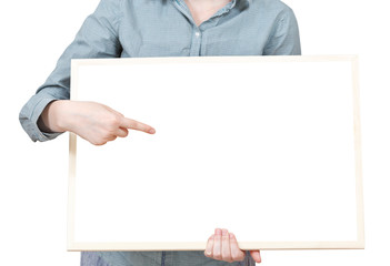 pointing on blank bulletin board in female hand