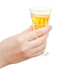 hand holds glass of dessert wine isolated
