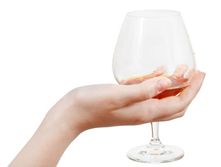 glass goblet with brandy in hand isolated