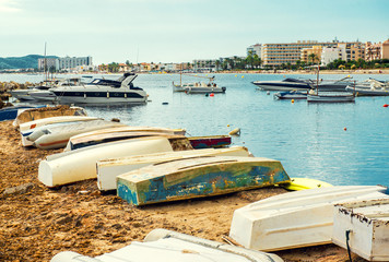 Old boats on the empty beach of Ibiza