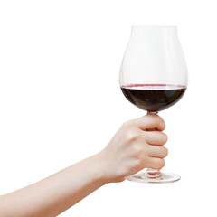 hand rises big glass with red wine