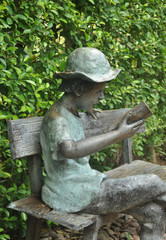 A bronze boy in the garden