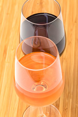 Glasses of Red and Pink Wine on Wooden Table