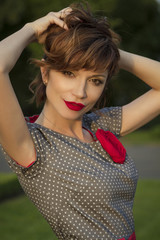 Portrait of charming lady with red lips