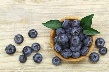 Blueberries in wooden bowl with copy space