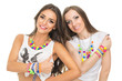 Two fashionable young women with colorful jewelry