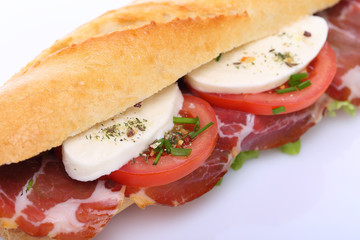 Sandwich with ham, mozzarella and tomato