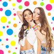 Two beautiful young women with colorful jewelry