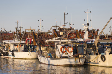 fishing boats in harbor - machine to collect the clams