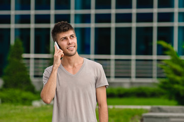 Young man and mobile phone