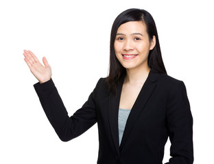 Businesswoman with hand show something