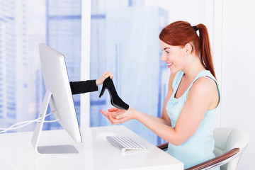 Businesswoman Shopping Shoes Online At Computer Desk
