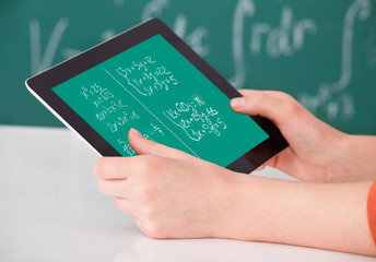 Student Solving Math's Problem On Digital Tablet In Classroom