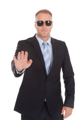 Confident Bodyguard Making Stop Gesture