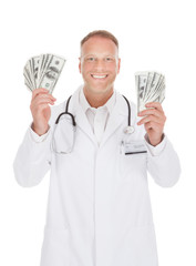 Smiling Male Doctor Holding Banknotes