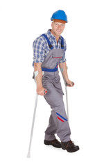 Handyman Walking With Crutches