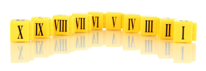 Educational cubes with Roman numerals isolated on white