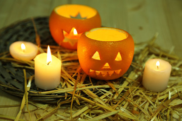 Festive composition with lanterns and candles on straw