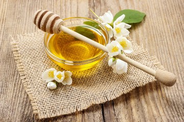 Jasmine honey on wooden table