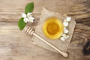 Jasmine honey on wooden table