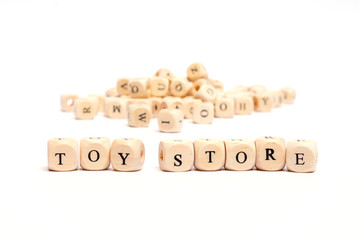 word with dice on white background- toy store