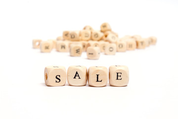 word with dice on white background- sale