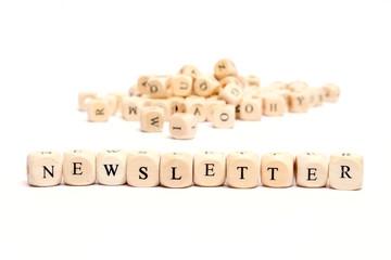 word with dice on white background- newsletter