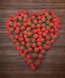 Raspberries and strawberries forming a heart shape